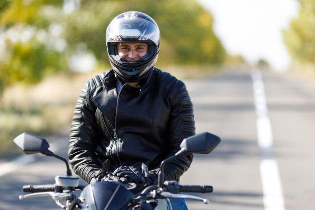 Close up of motorcyclist smiling